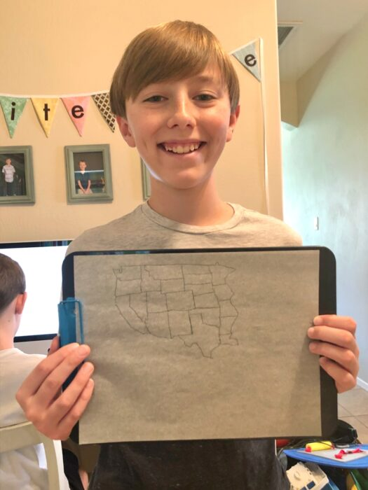 boy holding hand drawn map